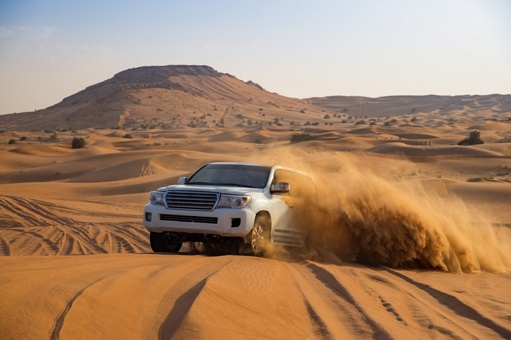 Car in Dubai sand dunes