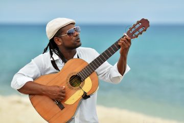 Caribbean man playing guitar