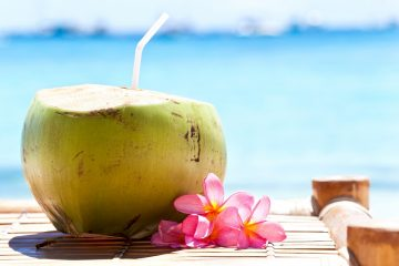 Coconut cocktail on beach