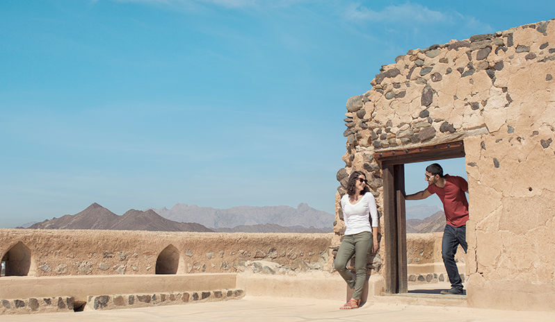 A couple visiting an ancient ruin during the day time